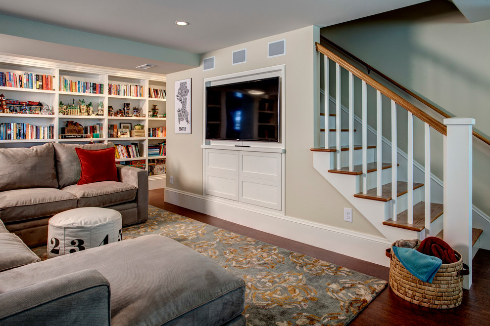 Inspiration for a timeless walk-out dark wood floor and brown floor basement remodel in Seattle with beige walls and no fireplace