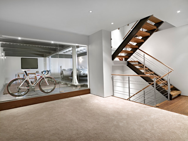 lower garage and stairs modern keller hobbyraum edmonton von habitat studio. Black Bedroom Furniture Sets. Home Design Ideas