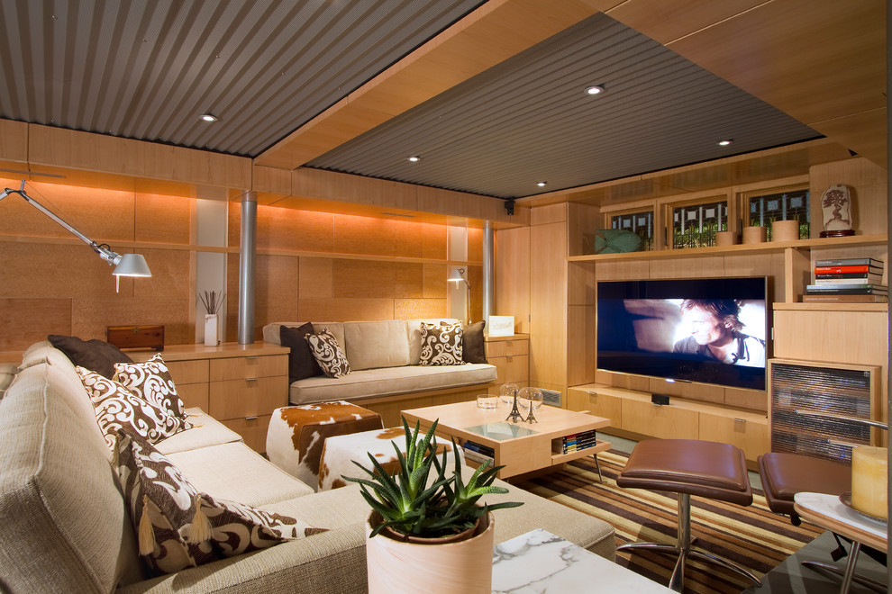 Inspiration for a mid-sized modern look-out carpeted and green floor basement remodel in Philadelphia with beige walls and no fireplace