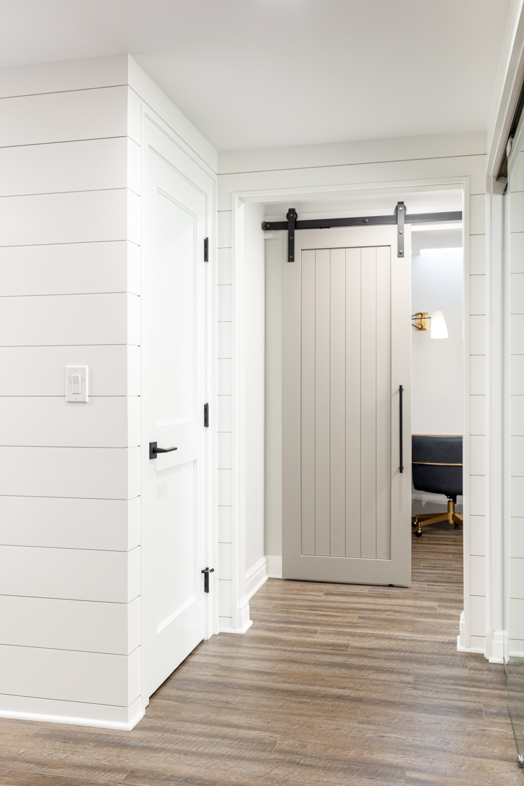 This Huntington Woods lower level renovation was recently finished in September of 2019. Created for a busy family of four, we designed the perfect getaway complete with custom millwork throughout, a
