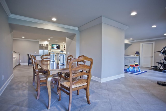 Example of a large transitional underground porcelain floor and gray floor basement design in Other with gray walls and no fireplace