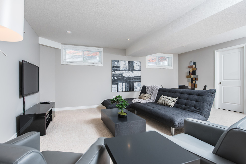 Inspiration for a large modern underground carpeted basement remodel in Toronto with gray walls and no fireplace