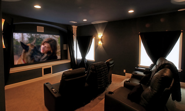 movie room in castle rock basement finish eclectic basement