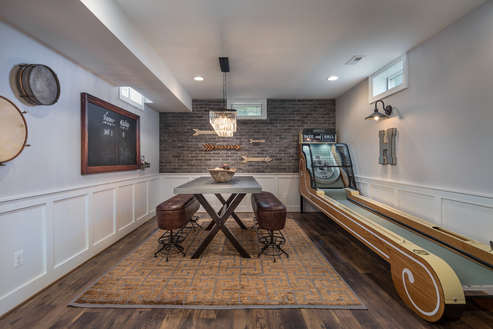 Example of a classic look-out dark wood floor basement game room design in DC Metro with gray walls