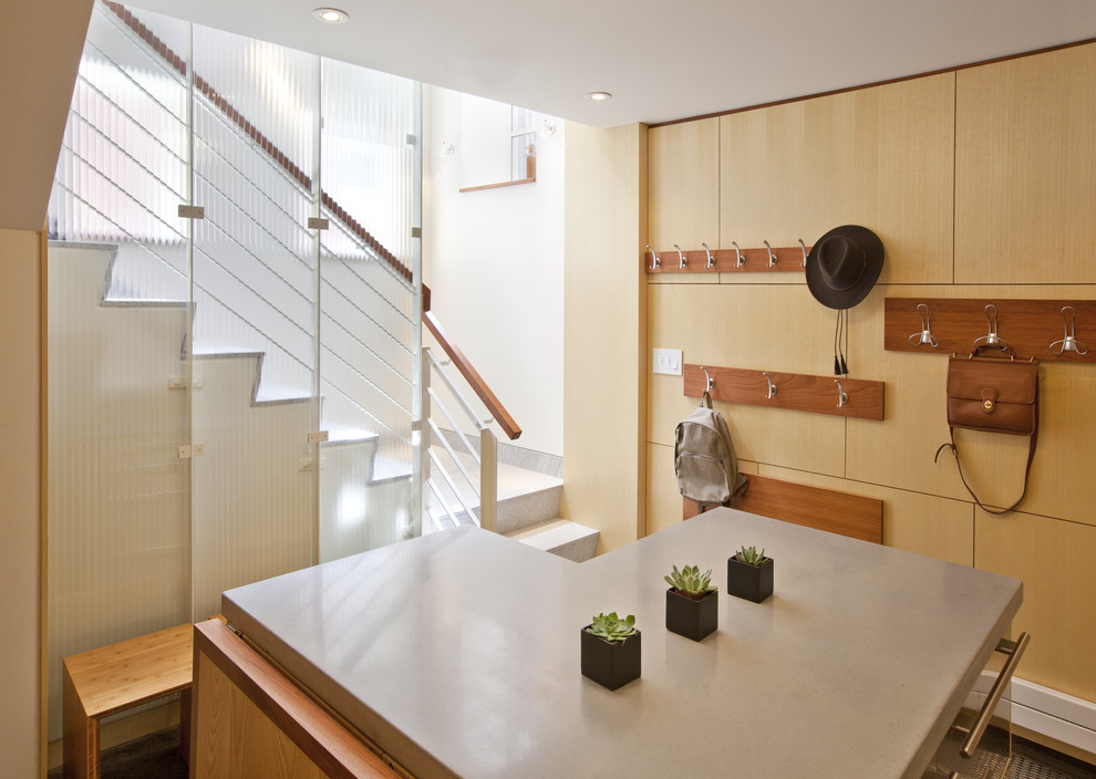 Example of a minimalist basement design in Boston with white walls