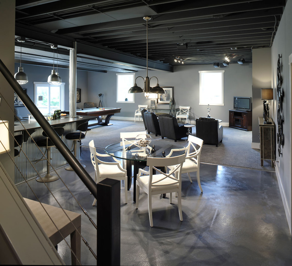 Example of a trendy walk-out concrete floor and gray floor basement design in Columbus with gray walls and no fireplace