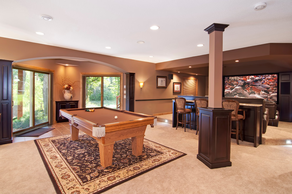 Basement game room - large traditional walk-out carpeted basement game room idea in Minneapolis with brown walls