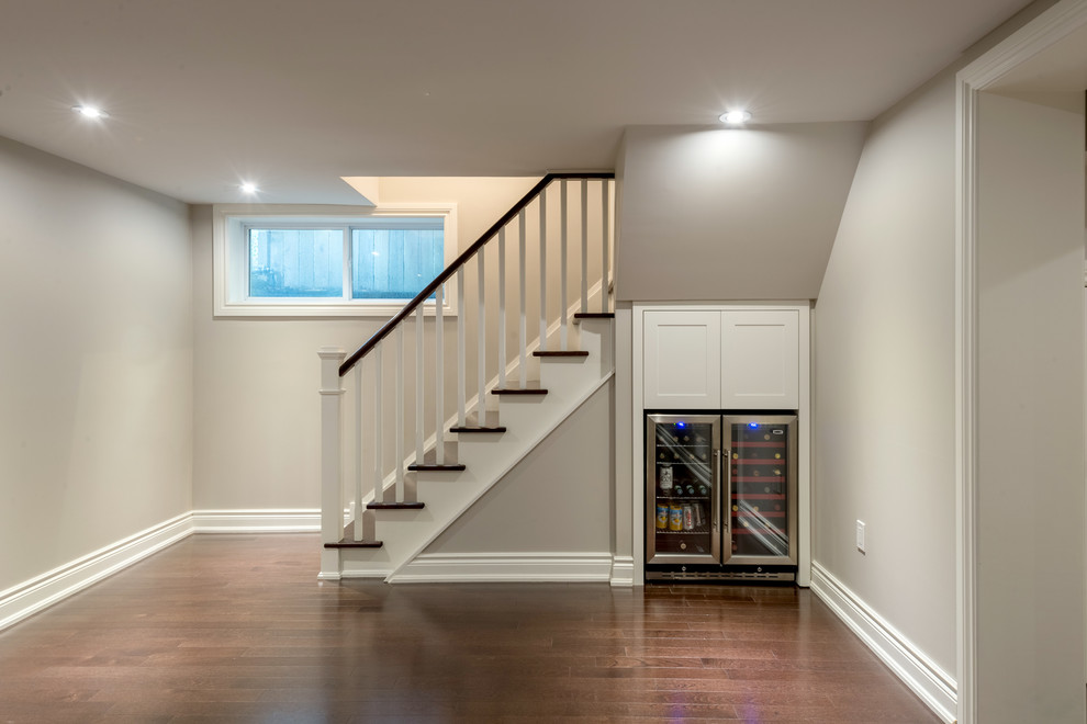 Inspiration for a small transitional look-out dark wood floor basement remodel in Toronto with gray walls and no fireplace