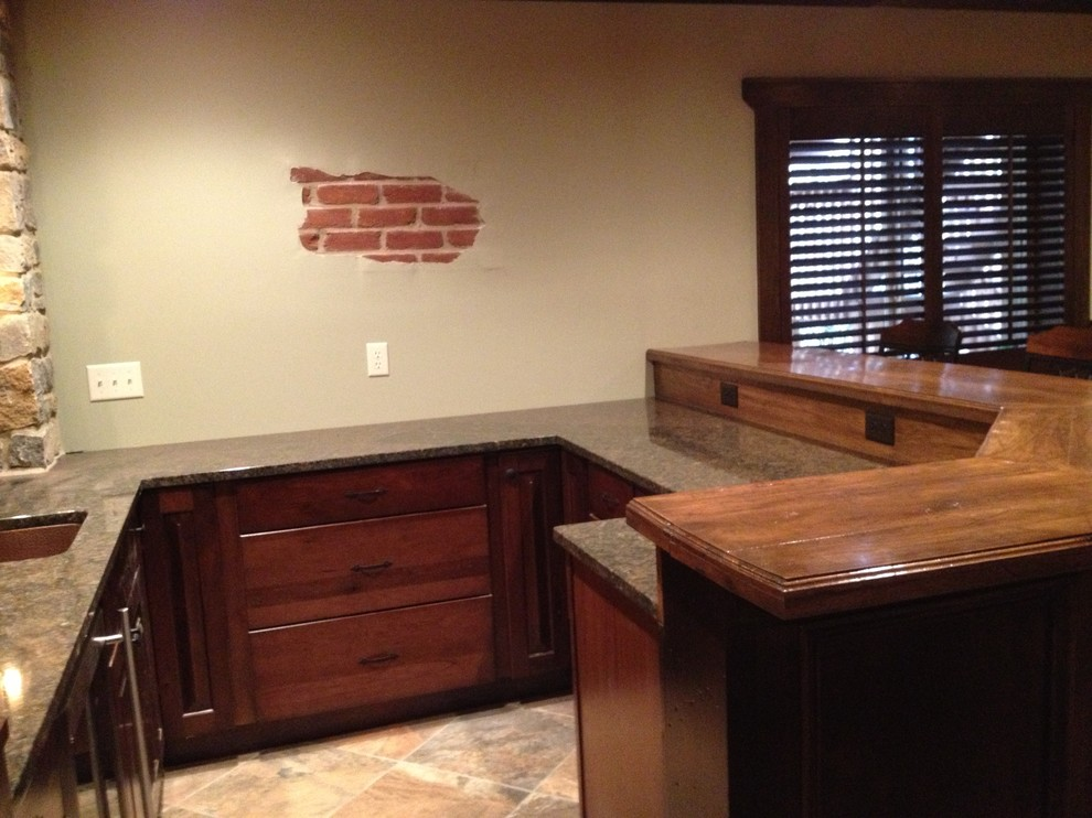 Example of a mid-sized mountain style walk-out basement design in Cincinnati with gray walls