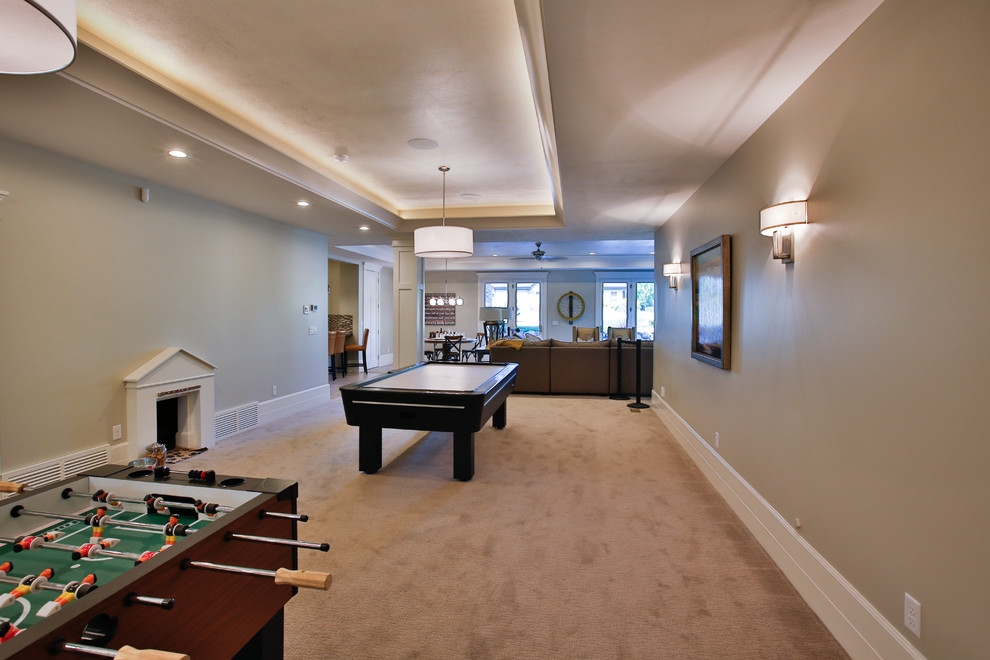 Basement - large transitional walk-out carpeted basement idea in Salt Lake City with beige walls
