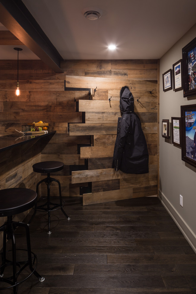 Inspiration for a rustic dark wood floor basement remodel in Ottawa with multicolored walls