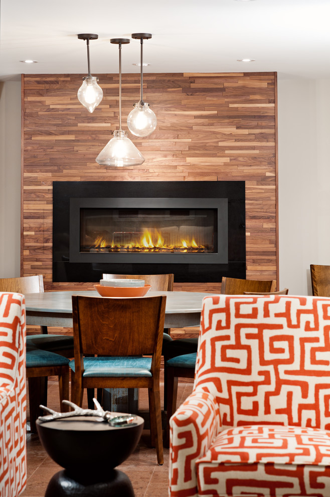 Inspiration for a large transitional underground brown floor basement remodel in Toronto with gray walls, a ribbon fireplace and a metal fireplace