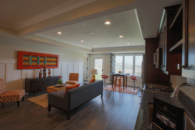 Example of a large transitional walk-out medium tone wood floor basement design in Salt Lake City with beige walls and no fireplace