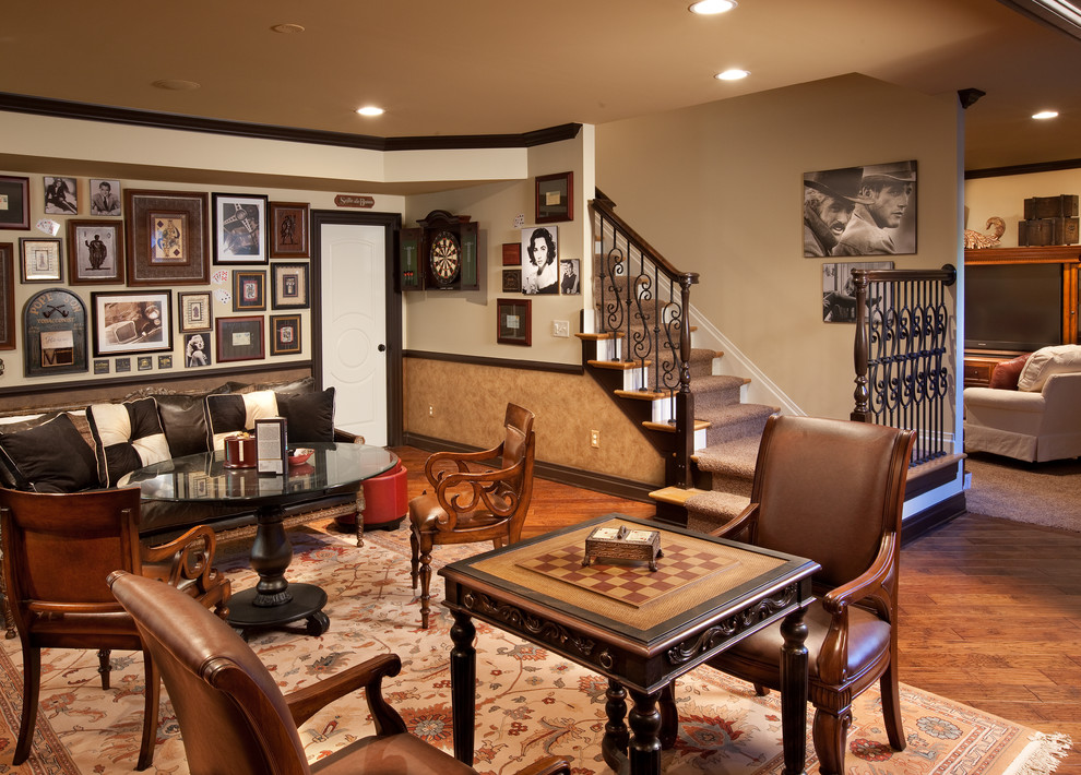 Example of a classic look-out medium tone wood floor and orange floor basement design in Columbus with beige walls and no fireplace