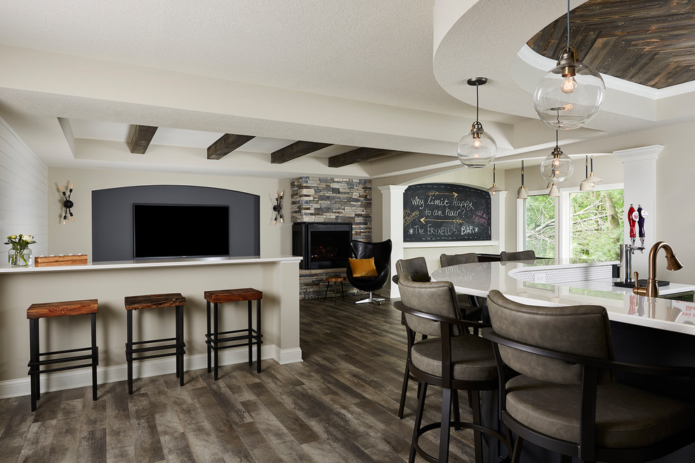 Basement - large farmhouse walk-out vinyl floor and multicolored floor basement idea in Minneapolis with gray walls, a two-sided fireplace and a stone fireplace