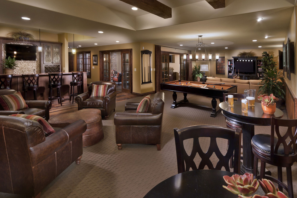 Tuscan walk-out carpeted basement photo in Denver with beige walls and no fireplace