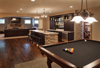 traditional basement with wide plank flooring