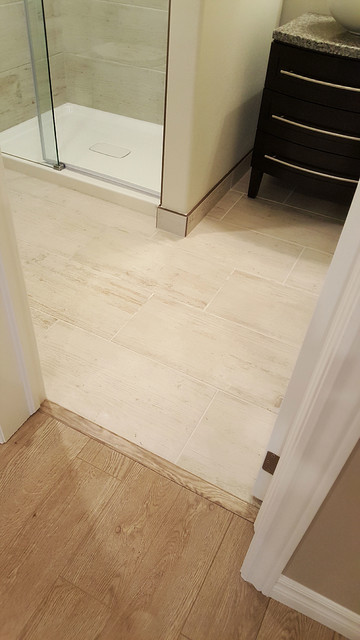 Transition From Laminate To Porcelain Flooring Modern Basement Other