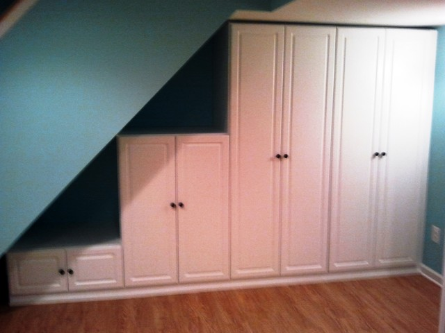 Under the stairs storage traditional basement - Under stairs closet ideas ...