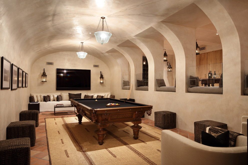 Example of a tuscan terra-cotta tile and orange floor basement design in Los Angeles with beige walls