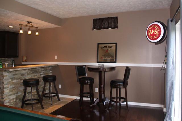 Walk Out Basement Finish With Basement Bar eclectic-basement