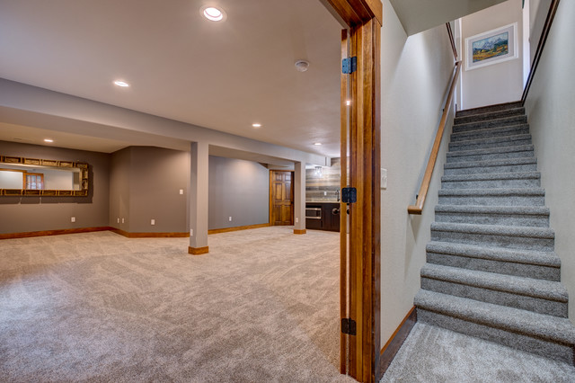 Basement - transitional carpeted basement idea in Other