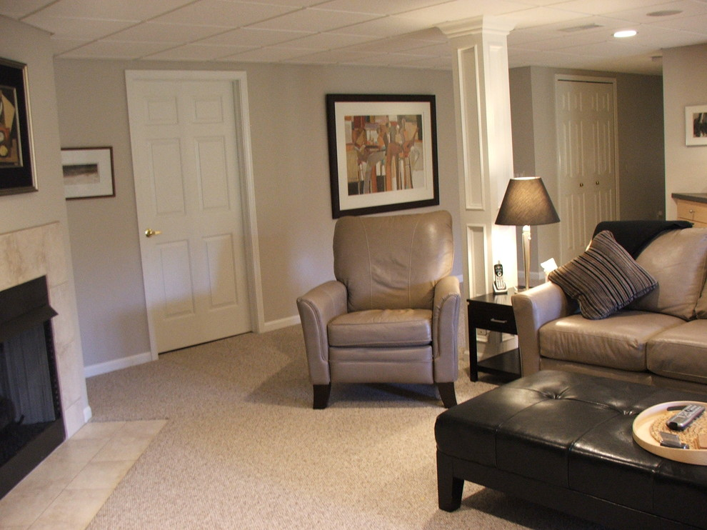 Example of a large classic basement design in Detroit with beige walls and a standard fireplace