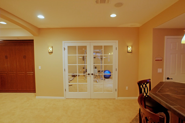 french door exercise room entry in basement finish eclectic basement