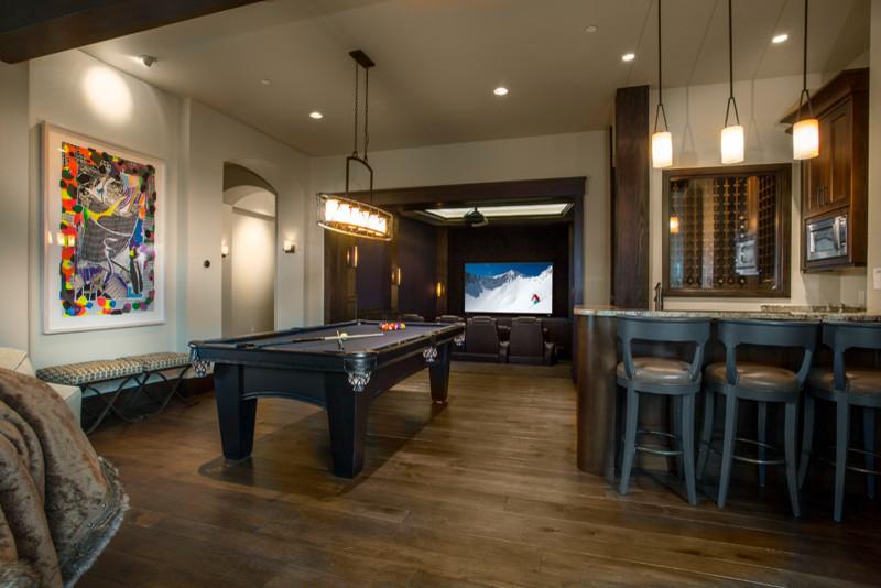 Huge eclectic dark wood floor basement photo in Salt Lake City