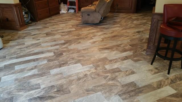 Wood Grain Tile On Diagonal In Springdale HomeModern Basement