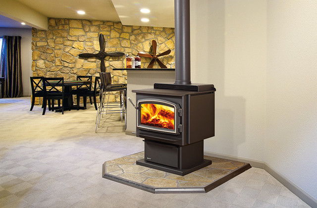 basement ideas mid sized basement designs beige walls wood stove