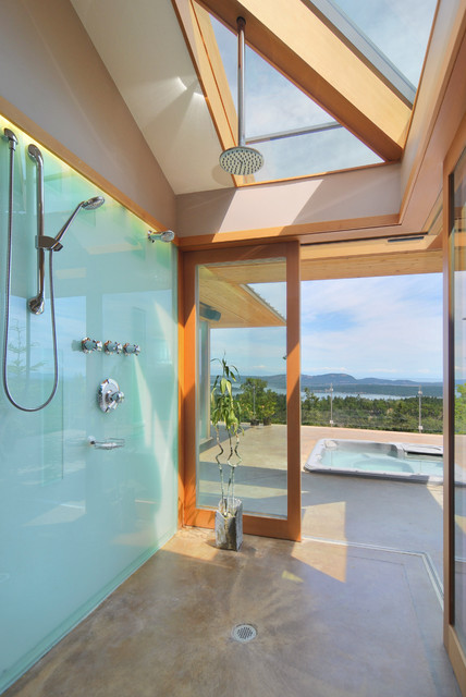 Inspiration for a contemporary concrete floor bathroom remodel in Toronto with a hot tub