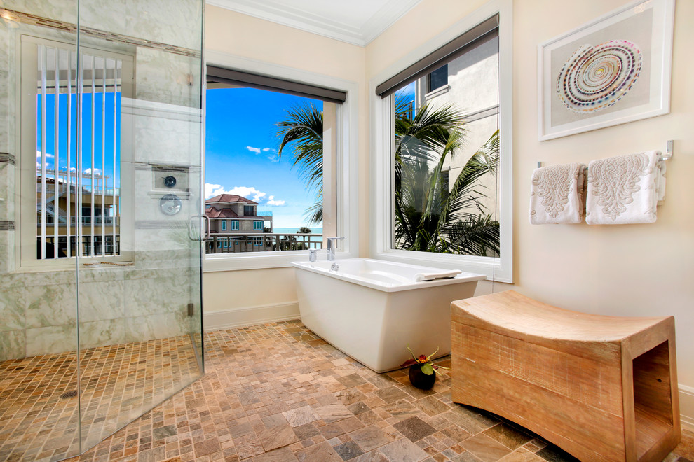 Island style master brown tile bathroom photo in Miami with beige walls and a hinged shower door
