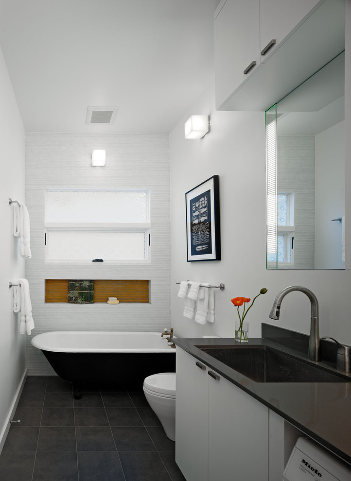 Inspiration for a mid-sized contemporary mosaic tile and white tile porcelain tile bathroom/laundry room remodel in San Francisco with an undermount sink, a one-piece toilet, flat-panel cabinets, white cabinets, quartz countertops and white walls