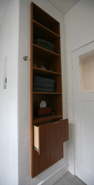 Custom teak linen cabinet recessed into wall.  bathroom