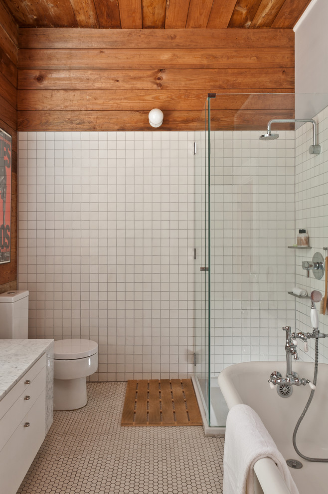 Bathroom - small contemporary master white tile and ceramic tile mosaic tile floor bathroom idea in Austin with flat-panel cabinets, white cabinets, marble countertops and a one-piece toilet