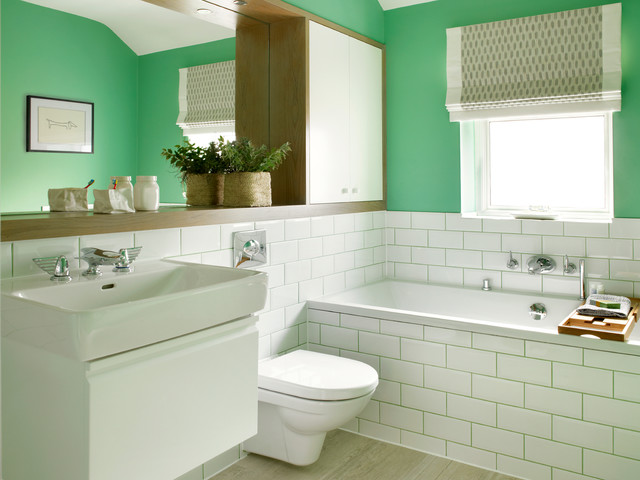 Example of a mid-sized transitional master white tile and subway tile porcelain floor alcove bathtub design in London with a console sink, flat-panel cabinets, white cabinets, a wall-mount toilet and green walls