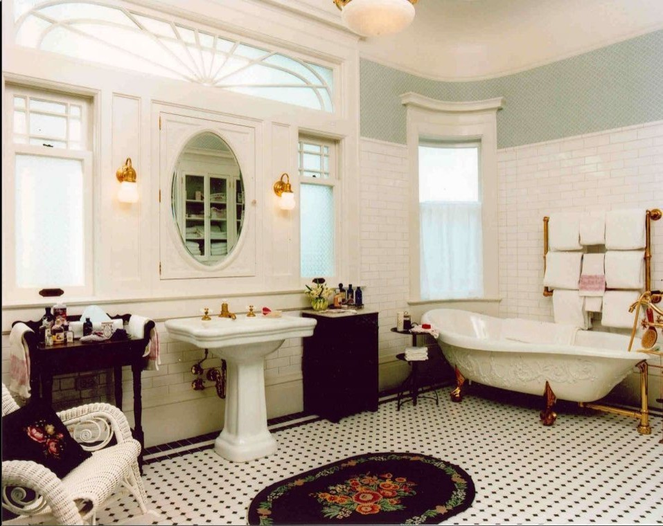19th century bathroom with free standing bathtub and towel warmers