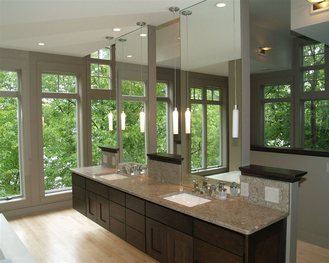 Contemporary bathroom idea in Milwaukee with dark wood cabinets