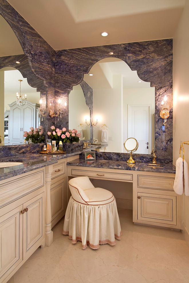 Bathroom - huge traditional master beige tile, gray tile and stone slab travertine floor bathroom idea in Phoenix with raised-panel cabinets, beige cabinets, an undermount sink, beige walls, granite countertops and blue countertops