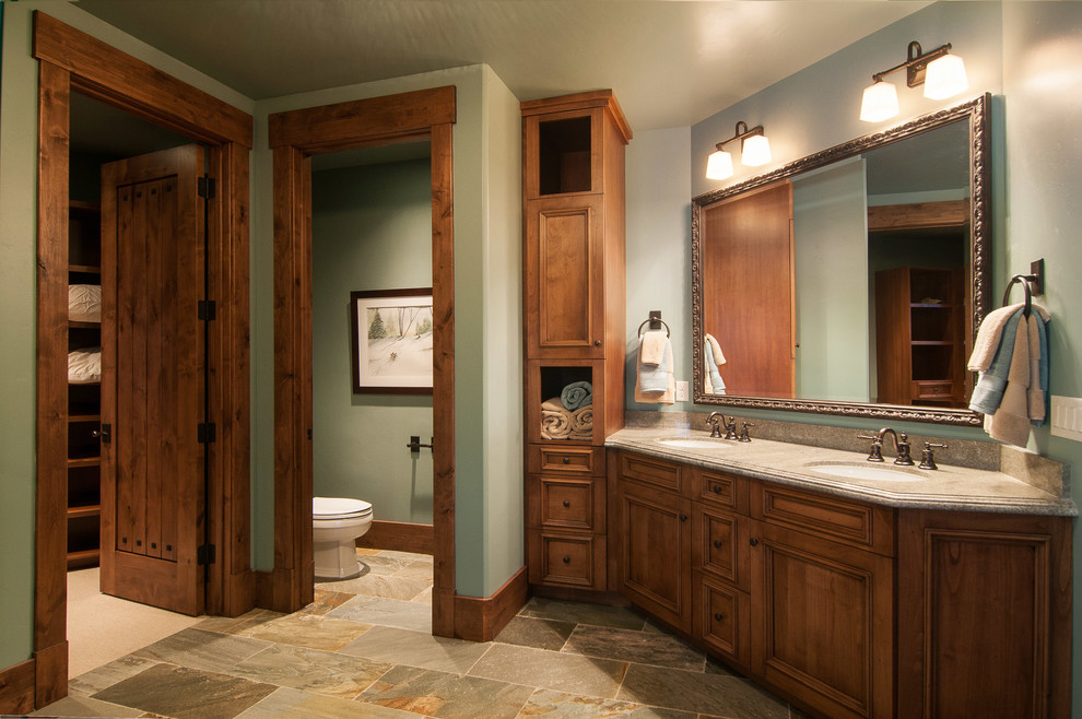 Example of a mountain style toilet room design in Salt Lake City with an undermount sink, recessed-panel cabinets and medium tone wood cabinets