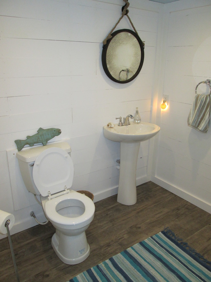 Bathroom - mid-sized beach style 3/4 dark wood floor bathroom idea in Indianapolis with a pedestal sink and white walls