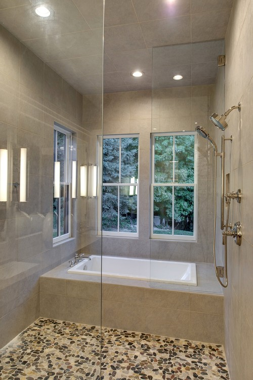 wet room shower next to a inset bath in-bedded into a tile structure