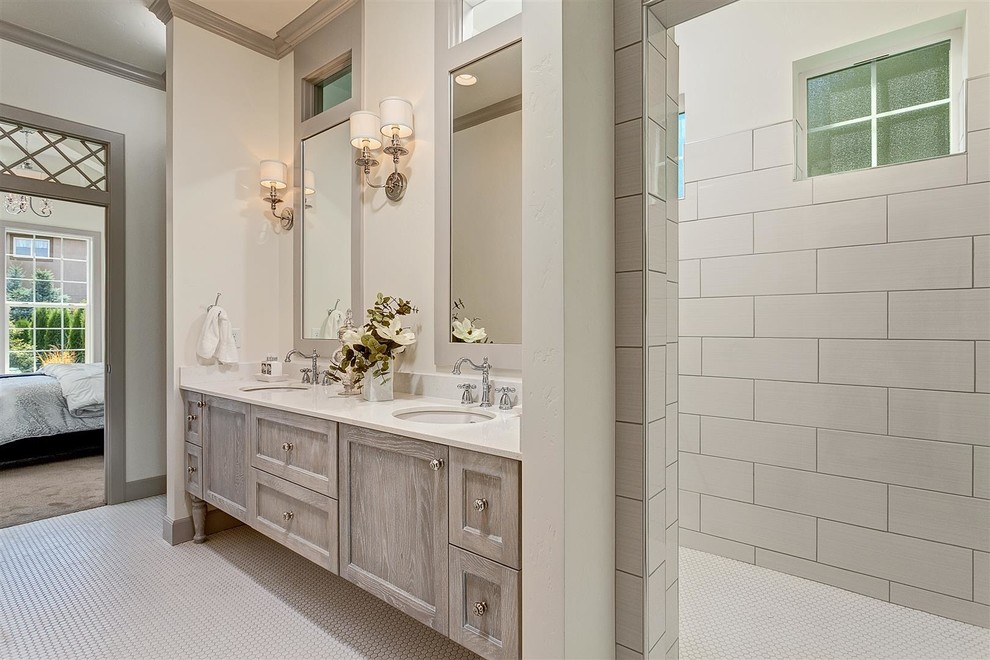 Bathroom - large traditional master gray tile and porcelain tile mosaic tile floor bathroom idea in Boise with an undermount sink, shaker cabinets, white walls, light wood cabinets and quartz countertops