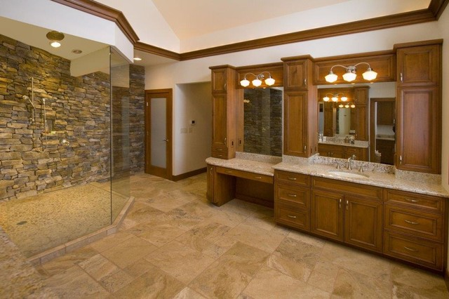 Inspiration for a large timeless master travertine floor doorless shower remodel in Other with an undermount sink, recessed-panel cabinets, medium tone wood cabinets, granite countertops and white walls