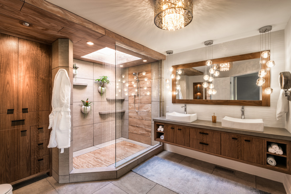 Inspiration for a contemporary 3/4 brown tile and gray tile gray floor corner shower remodel in Minneapolis with flat-panel cabinets, medium tone wood cabinets, gray walls, a vessel sink and gray countertops