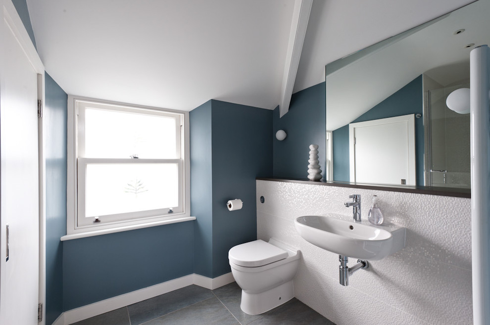 Trendy bathroom photo in Other with a wall-mount sink
