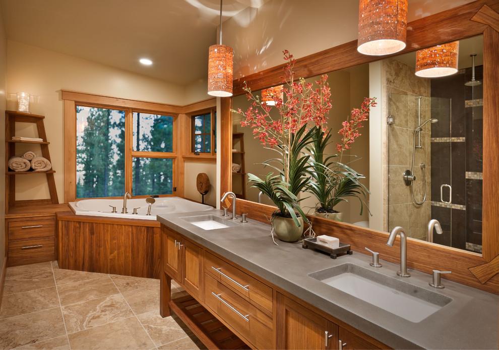 Drop-in bathtub - rustic drop-in bathtub idea in Sacramento with an undermount sink, medium tone wood cabinets, beige walls, shaker cabinets and gray countertops