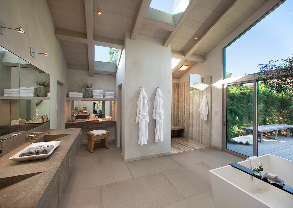 Huge trendy master porcelain tile bathroom photo in Santa Barbara with flat-panel cabinets, gray cabinets, gray walls, an integrated sink and quartz countertops