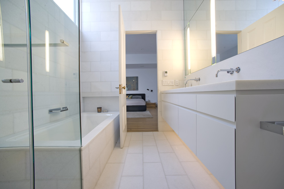 Inspiration for a contemporary white tile white floor alcove bathtub remodel in San Francisco with flat-panel cabinets and white cabinets